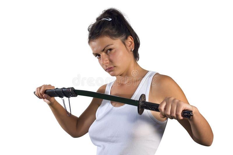 Frau mit Klinge lizenzfreie stockfotos