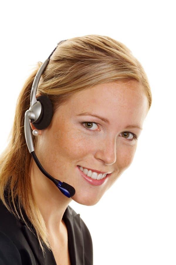 Frau mit Kopfhörer im Kundendienst stockfotos