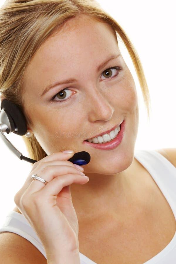 Frau mit Kopfhörer im Kundendienst lizenzfreie stockbilder