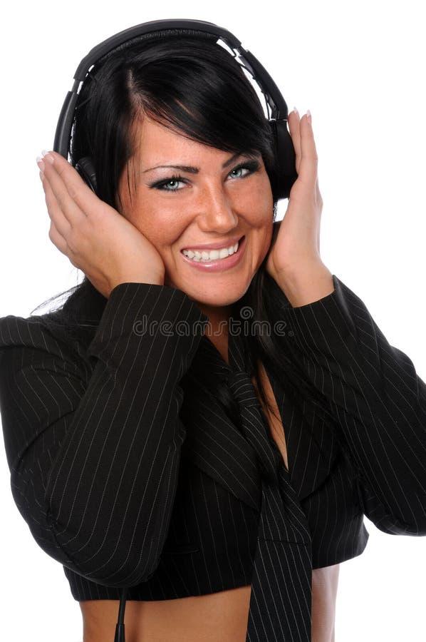 Frau mit Kopfhörern lizenzfreie stockbilder