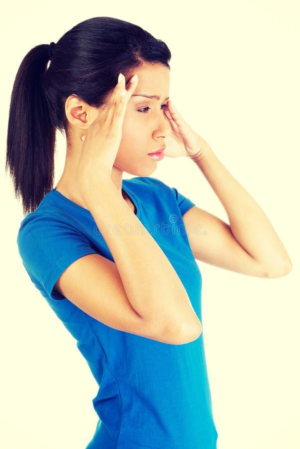 Frau mit Kopfschmerzen oder Problem stockbilder