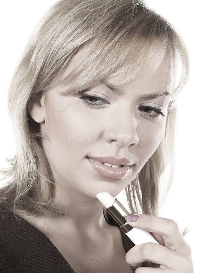 Frau mit Lippenstift stockbilder