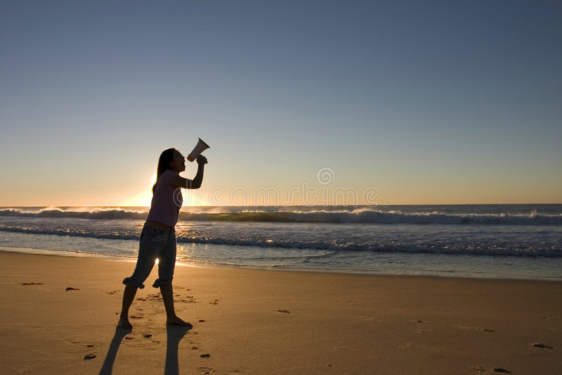 Frau mit Megaphon lizenzfreie stockfotografie