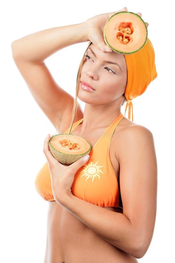 Frau mit Melonen stockfotos