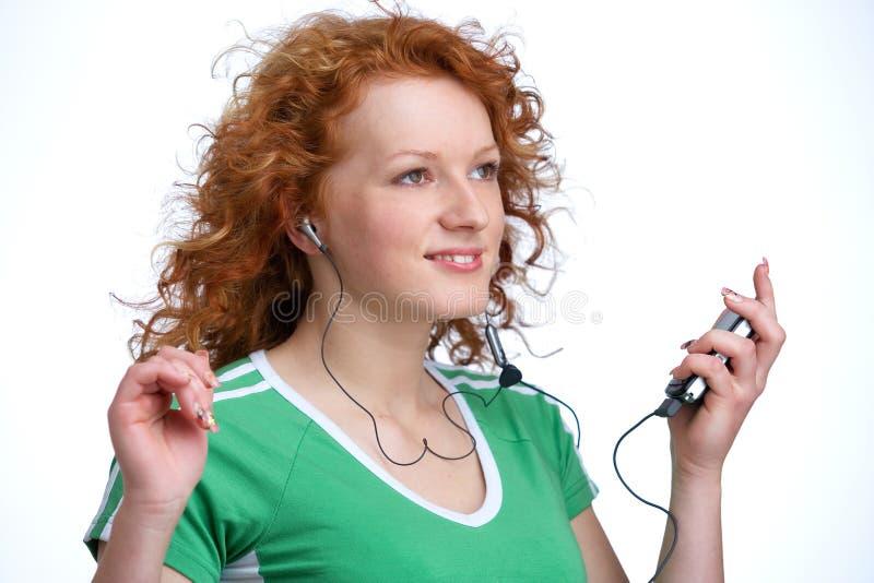 Frau mit mp3-player stockfoto