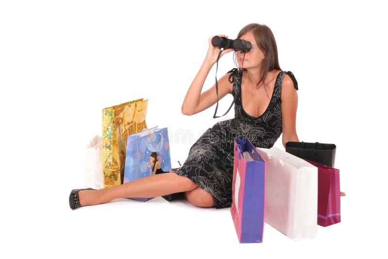 Frau mit Papiertüten und binokulares stockbilder