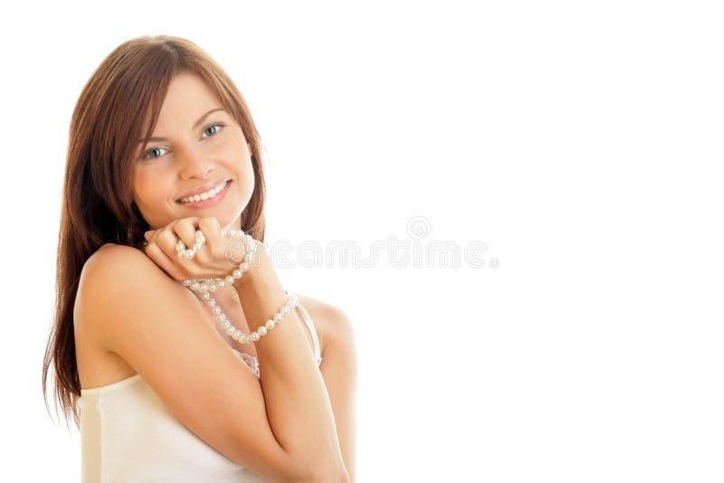 Frau mit Perlen stockfotos
