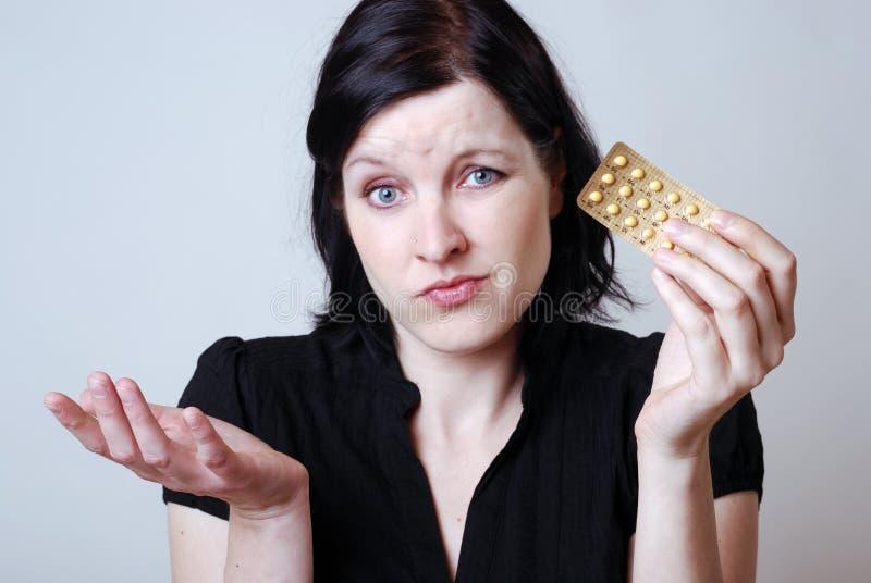 Frau mit Pille stockbilder