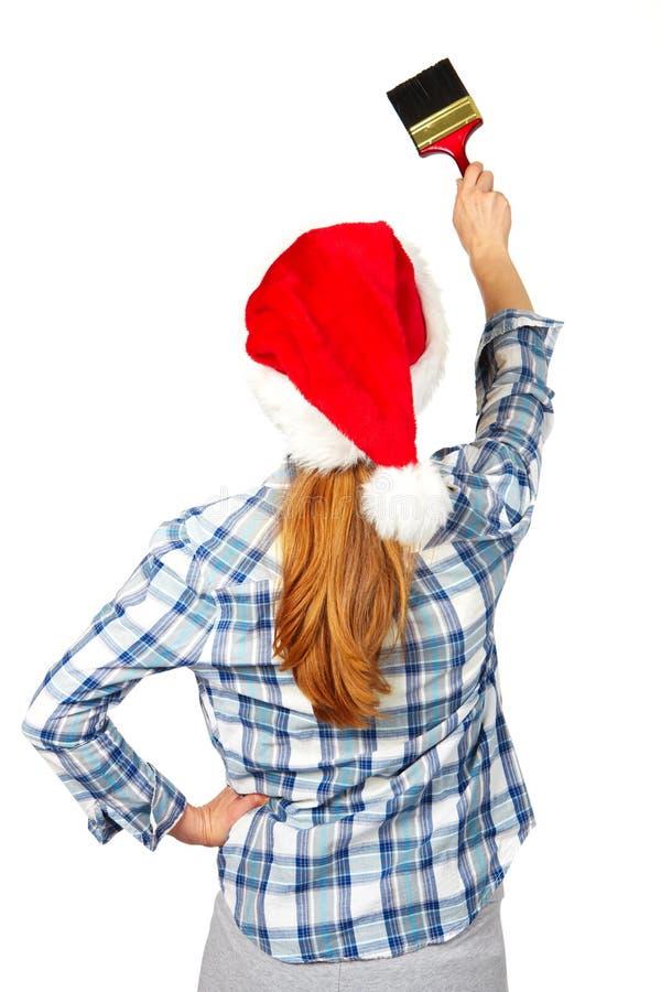 Frau mit Pinsel Weihnachten stockbild