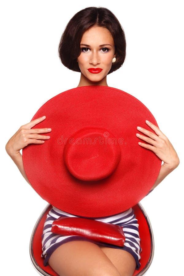 Frau mit rotem Hut stockbild