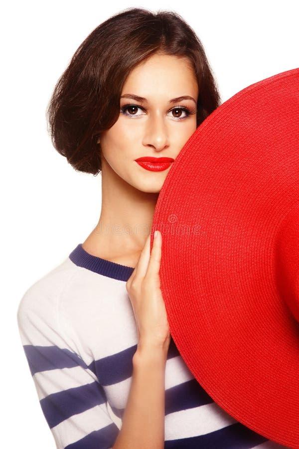 Frau mit rotem Hut lizenzfreie stockfotos