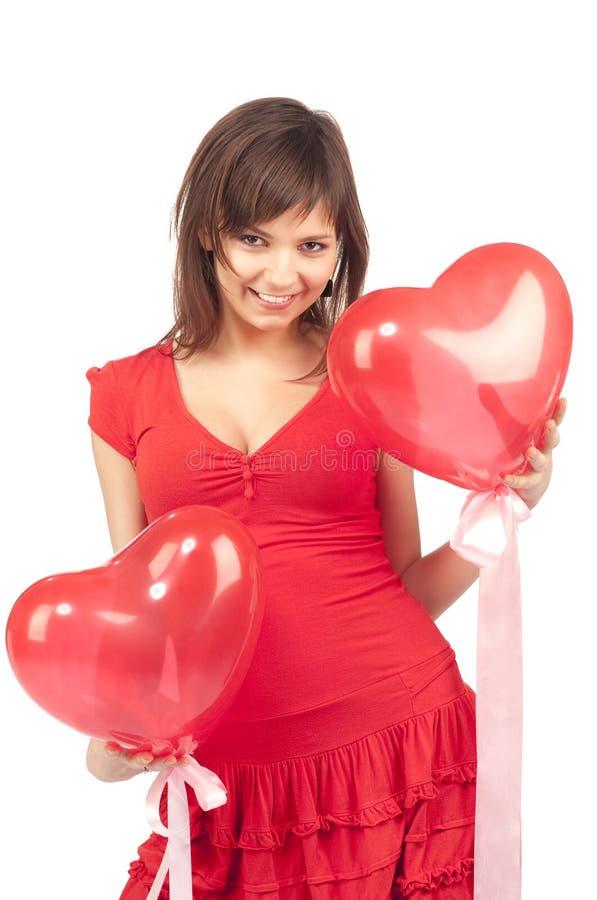 Frau mit rotem Innerballon stockfotografie