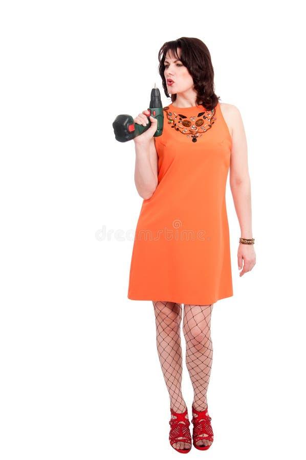 Frau mit Schraubenzieher stockfotos