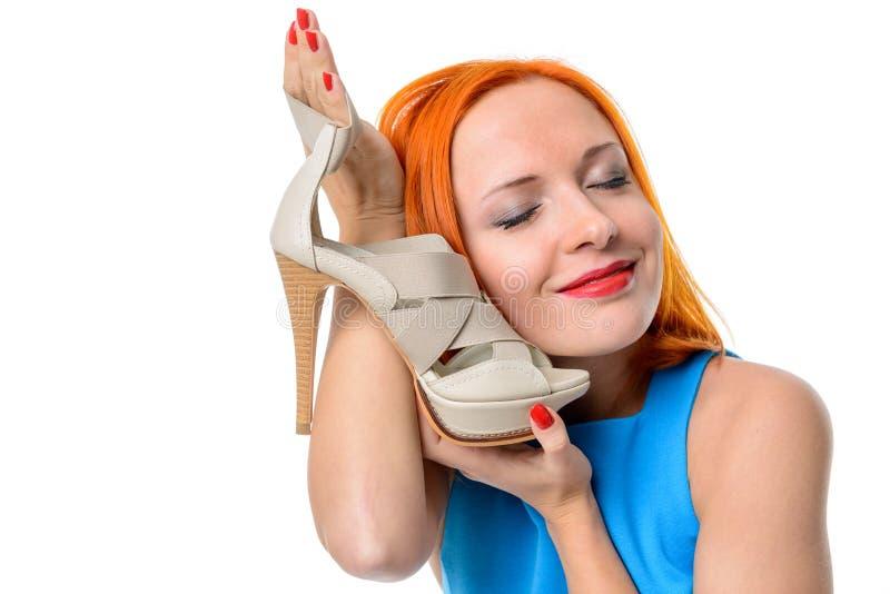 Frau mit Schuh des hohen Absatzes lizenzfreie stockbilder