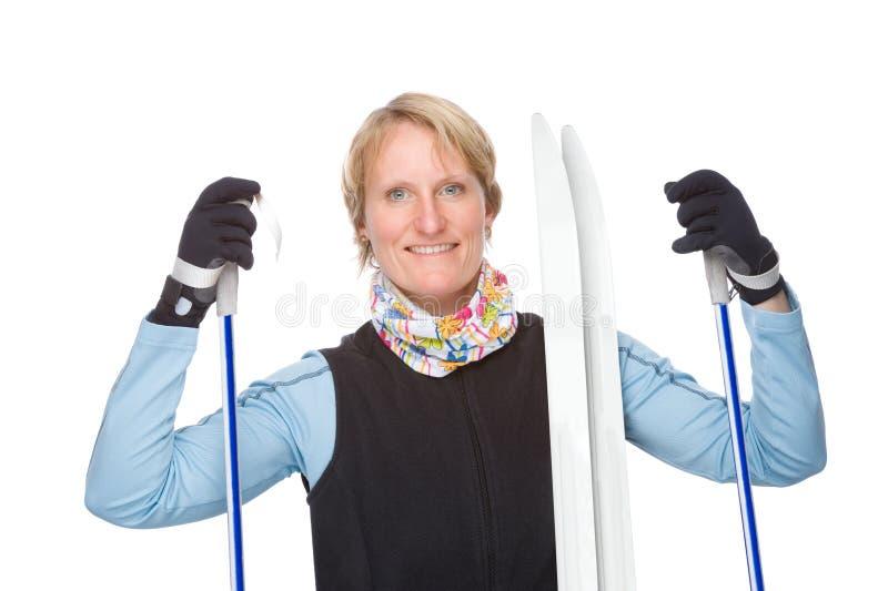 Frau mit Ski lizenzfreies stockbild
