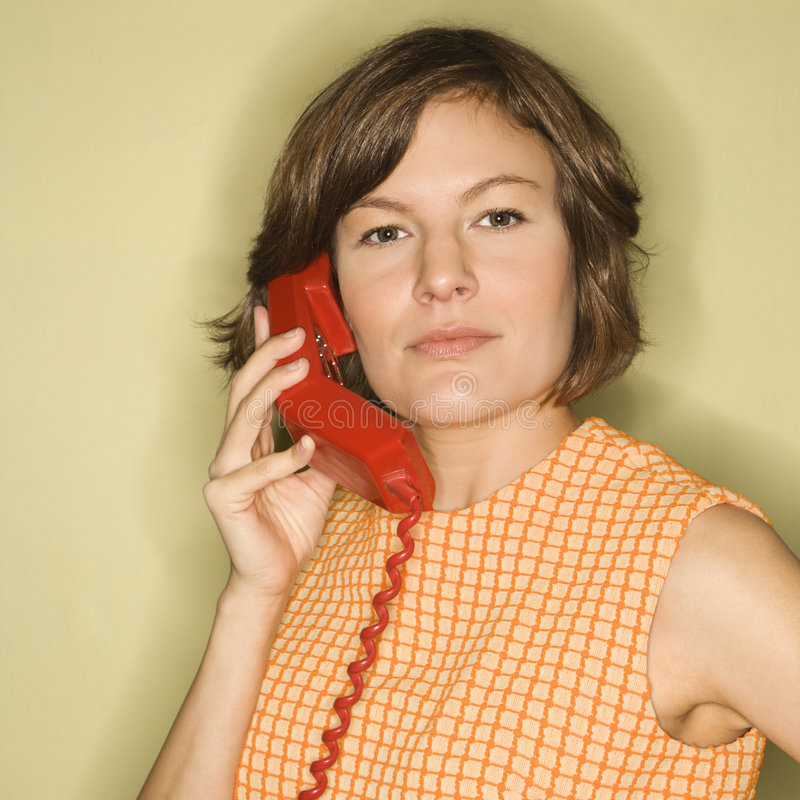 Frau mit Telefon. lizenzfreie stockbilder