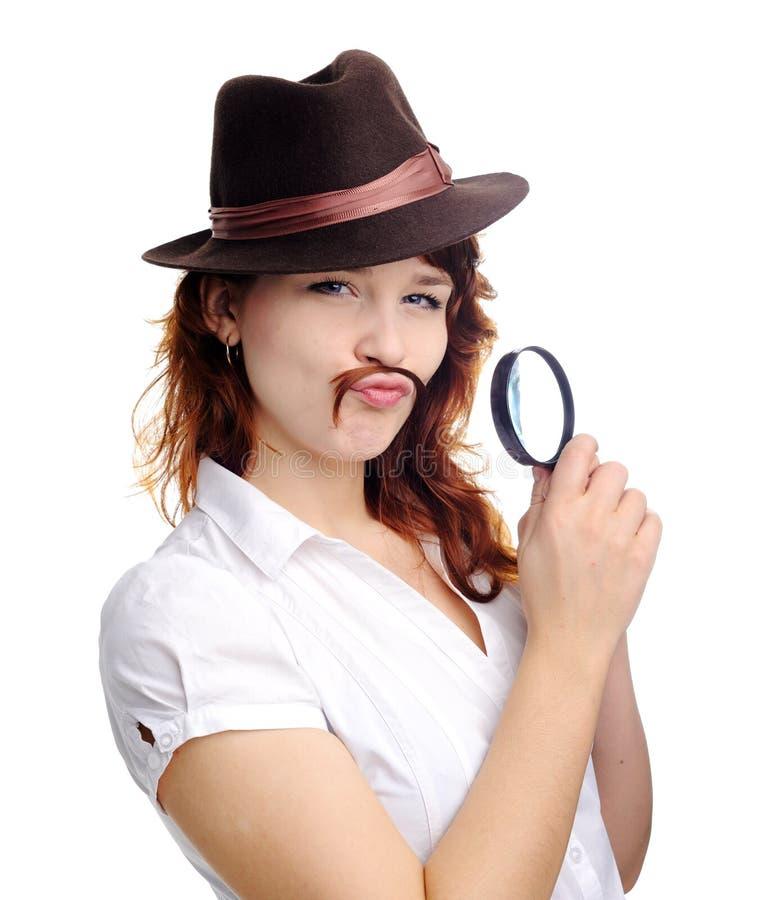 Frau mit Vergrößerungsglas lizenzfreie stockbilder