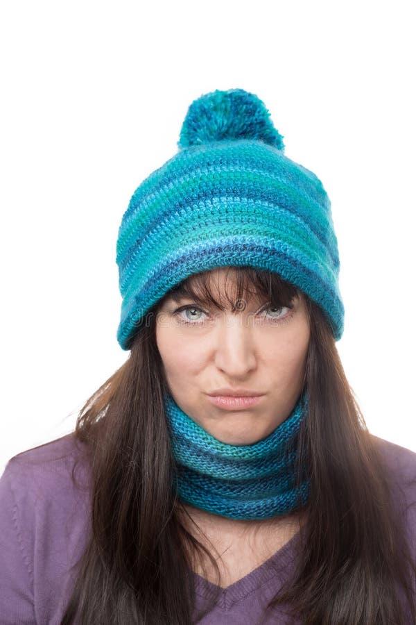 Frau mit verspottendem Ausdruck stockbild