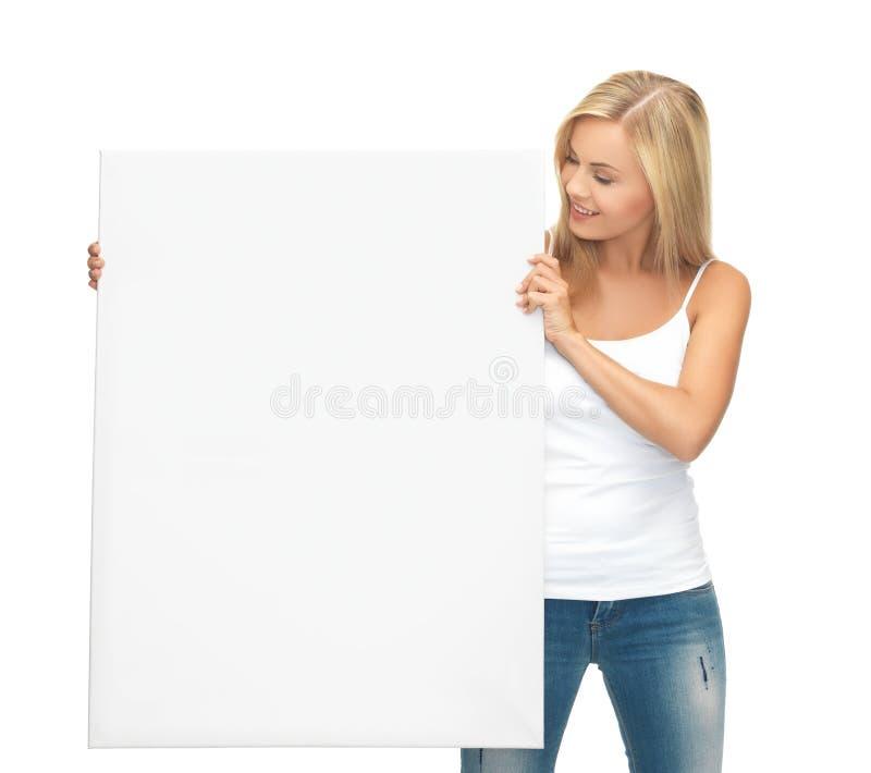Frau mit weißem leerem Brett lizenzfreie stockbilder