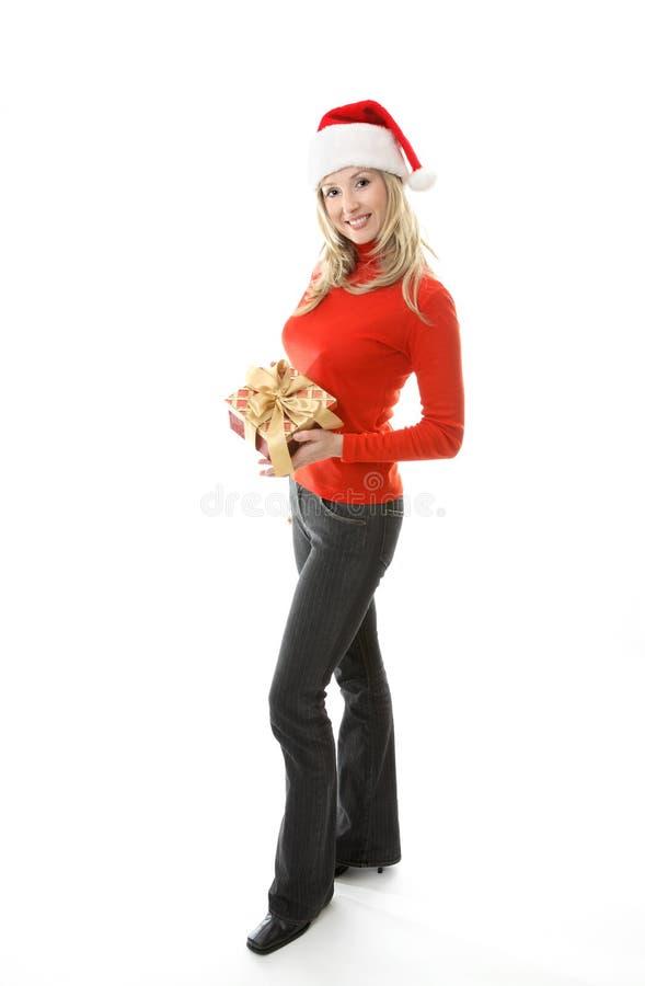 Frau mit Weihnachtsgeschenk stockfoto
