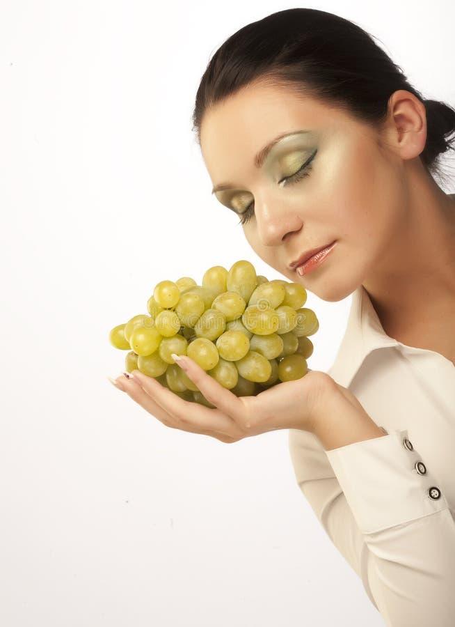 Frau mit Weintraube stockfotos