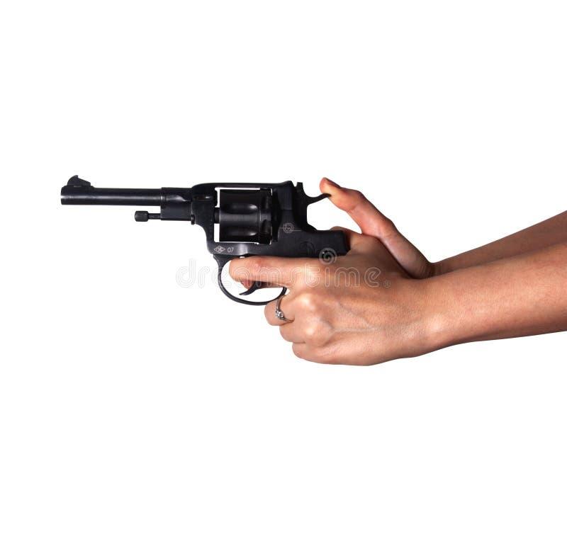 Frau ` s Hand mit einem Gewehr lizenzfreie stockfotografie