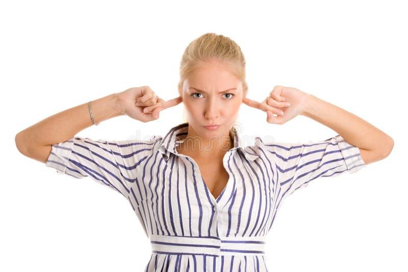 Frau steckt Finger in den Ohren ein lizenzfreies stockfoto