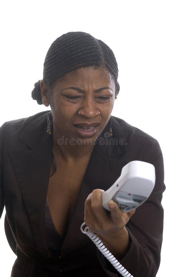 Frau am Telefon stockbild