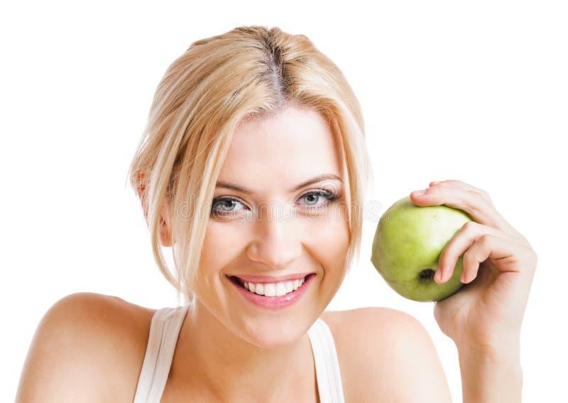 Frau und Apfel stockfotografie