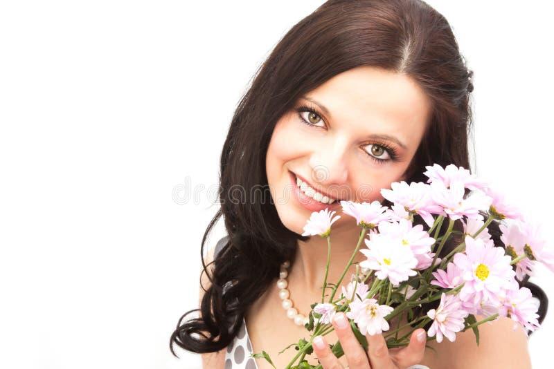 Frau und Blumen stockfotografie