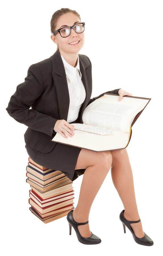 Frau und ein Stapel der Bücher lizenzfreies stockfoto