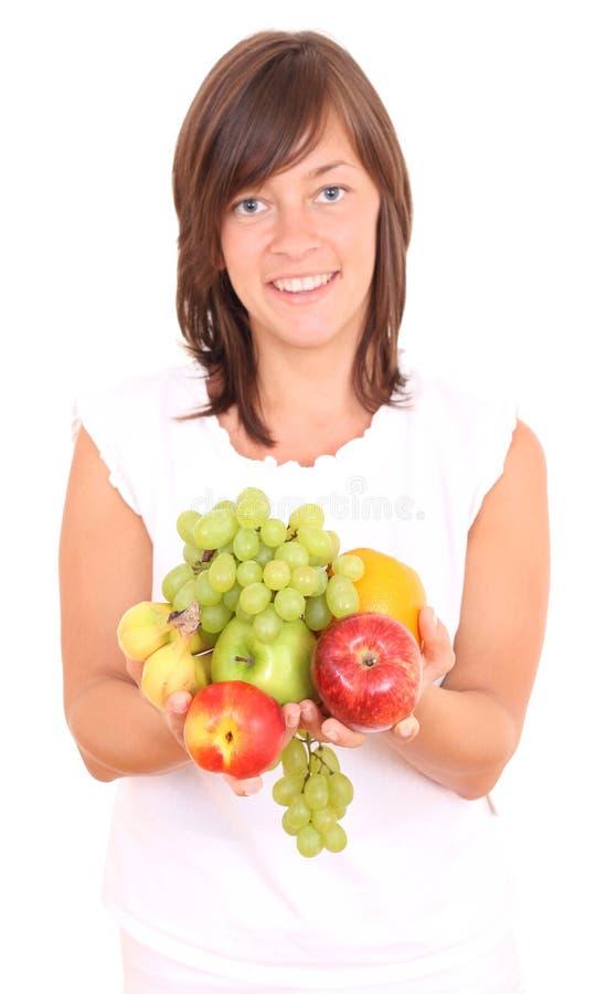 Frau und Früchte lizenzfreie stockbilder
