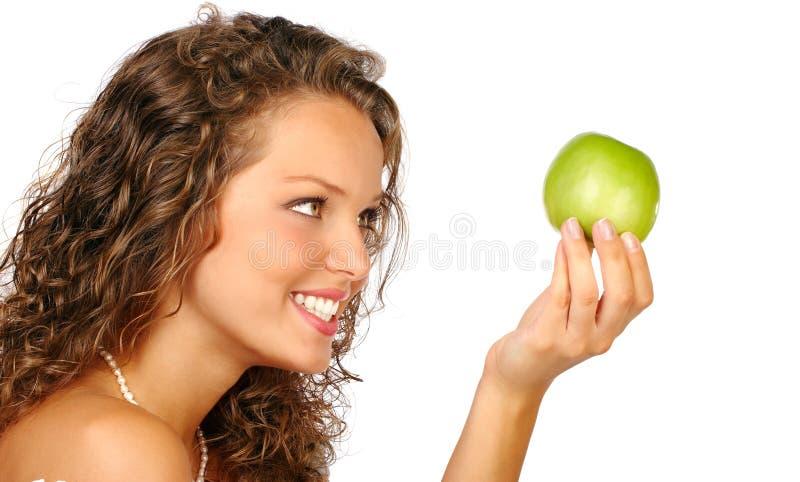 Frau und grüner Apfel lizenzfreies stockbild