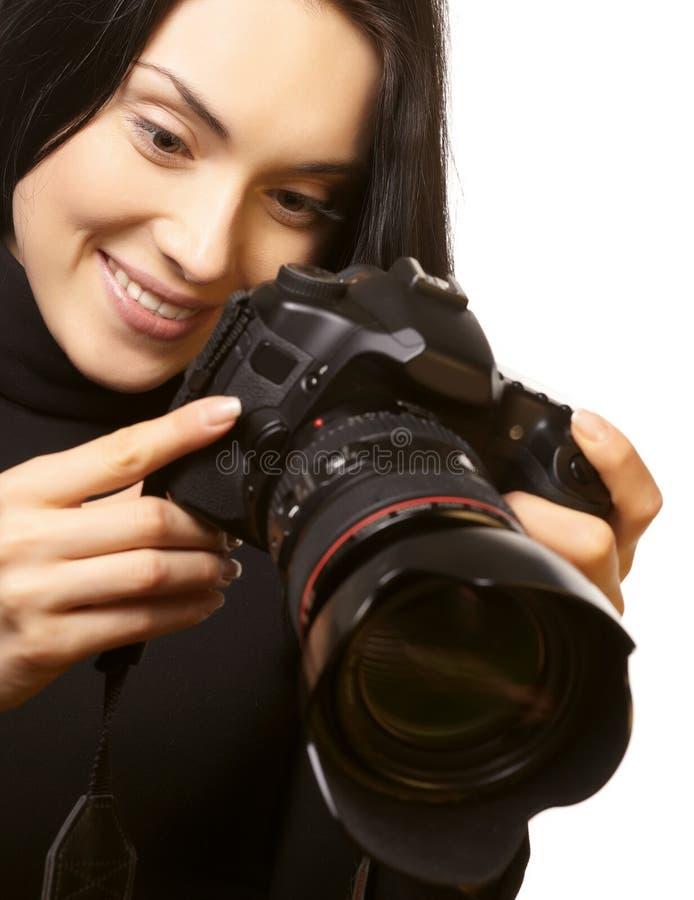 Frau und Kamera lizenzfreie stockfotos