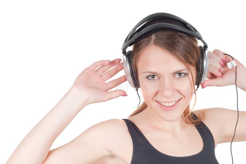 Frau und Kopfhörer lizenzfreies stockfoto