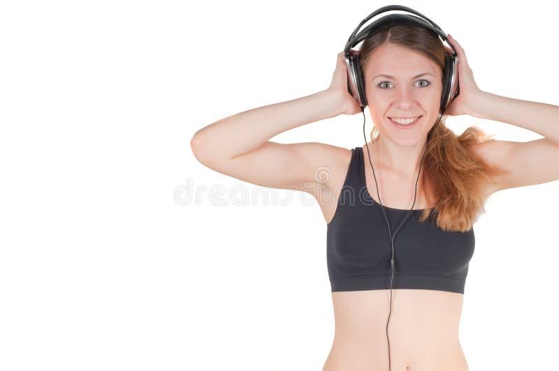 Frau und Kopfhörer lizenzfreie stockfotos