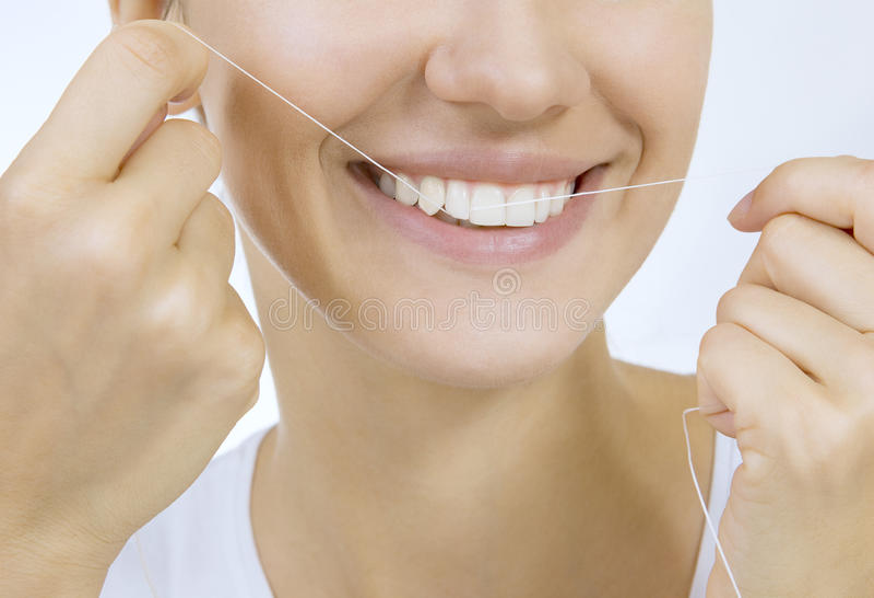 Frau und Zahnglasschlacke lizenzfreie stockfotos