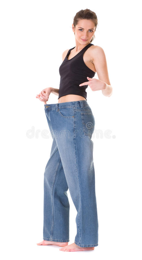 Frau zeigt ihr alte sehr große Jeans, wieght Verlust stockbilder