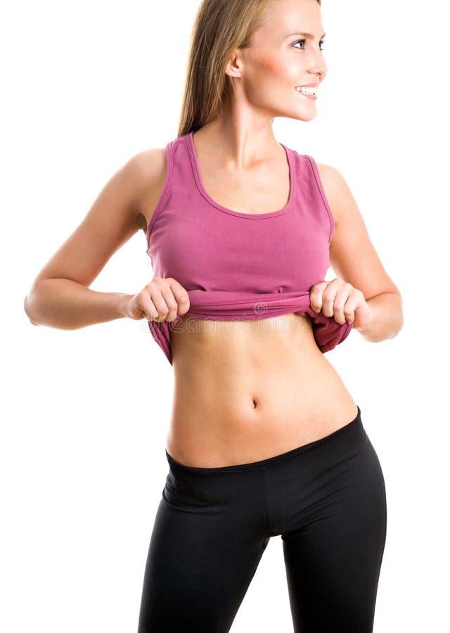 Frau zeigt ihren Bauch stockfotografie