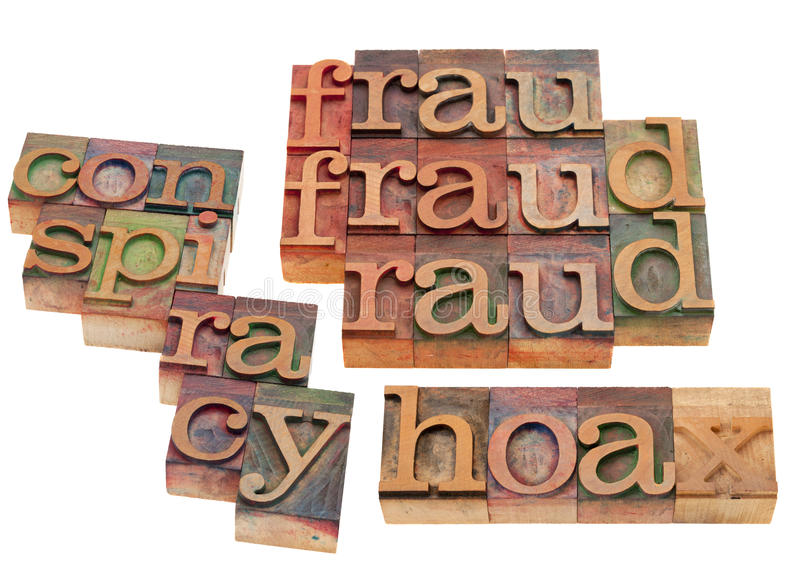 Fraud, hoax and conspiracy. Word collage t in vintage wooden letterpress printing blocks isolated on white stock photography