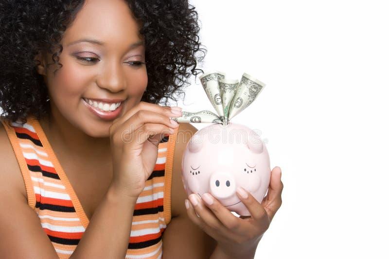 Frauen-Einsparung-Geld stockfotografie