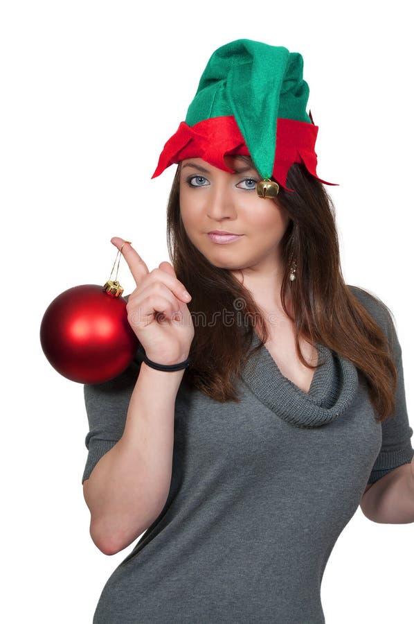 Frauen-Elf-Holding-Weihnachtsverzierung stockfoto