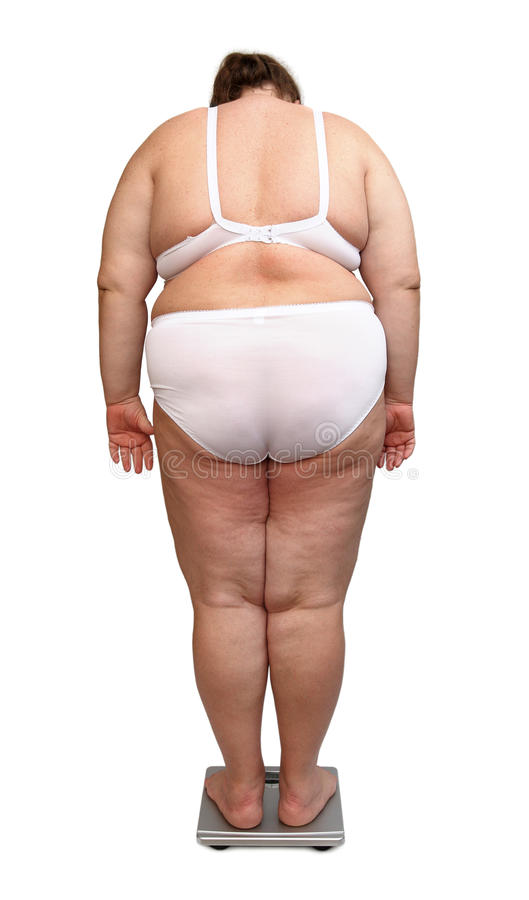 Frauen mit Übergewicht von hinten auf Skalen lizenzfreies stockbild
