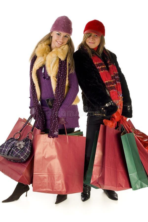 Frauen mit Einkaufenbeuteln stockfotos