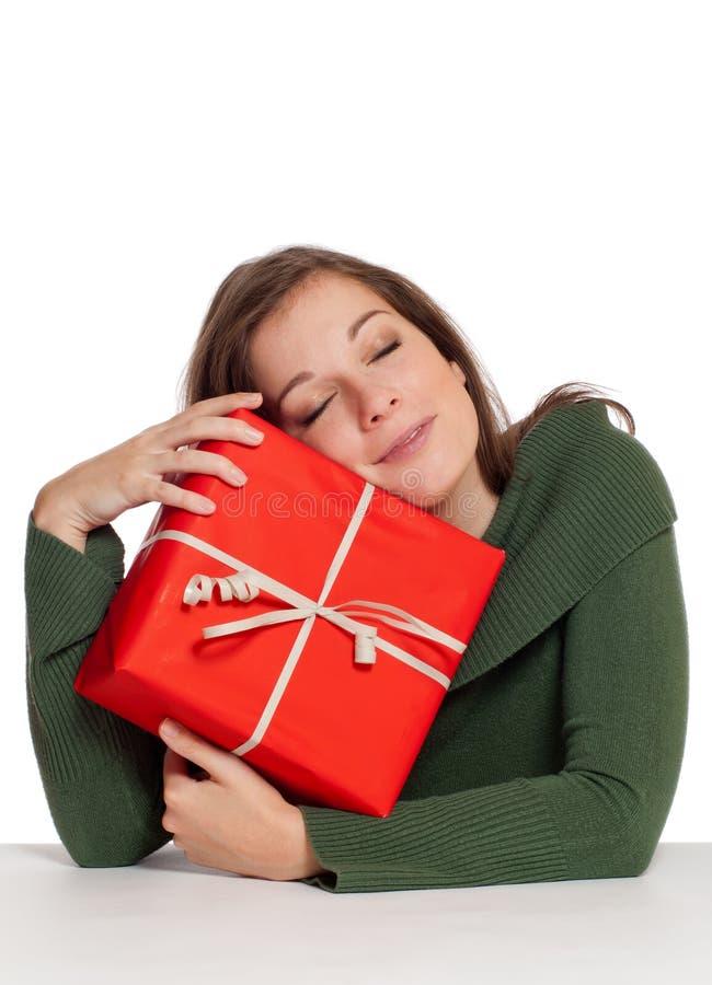 Frauen mit rotem Geschenk lizenzfreies stockbild