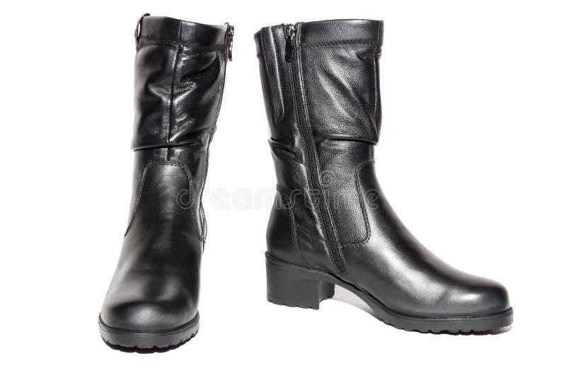 Frauen ` s lederne schwarze Stiefel lizenzfreie stockbilder