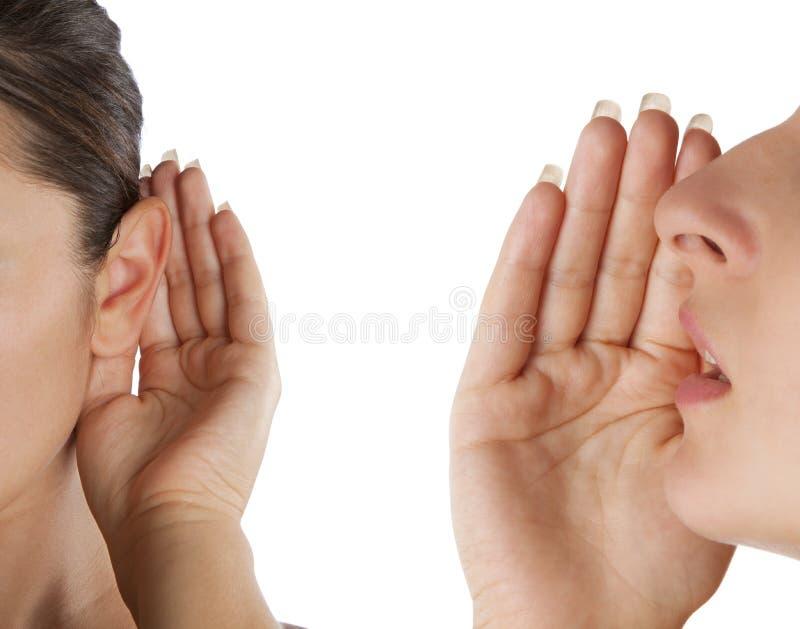 Frauen sagen und hören stockfoto