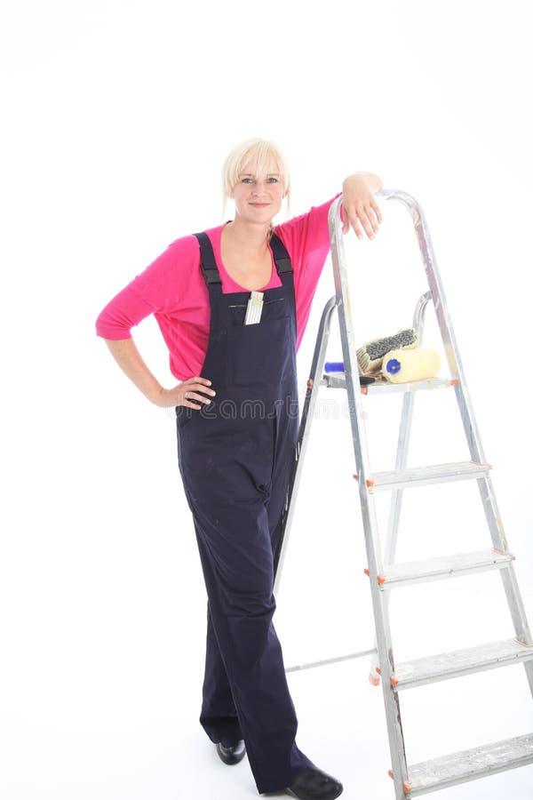 Frauendekorateur betriebsbereit zur Arbeit stockfotos