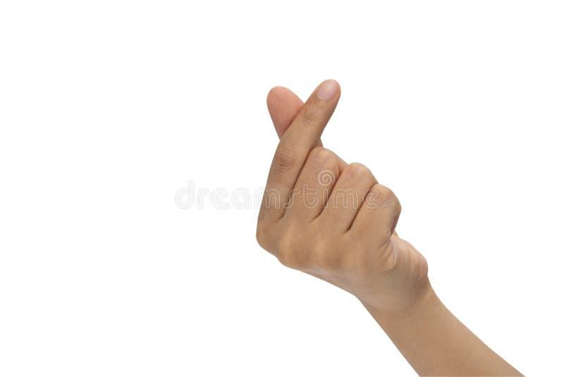 Frauenhände, die das Miniherz lokalisiert auf weißem machen lizenzfreie stockfotos
