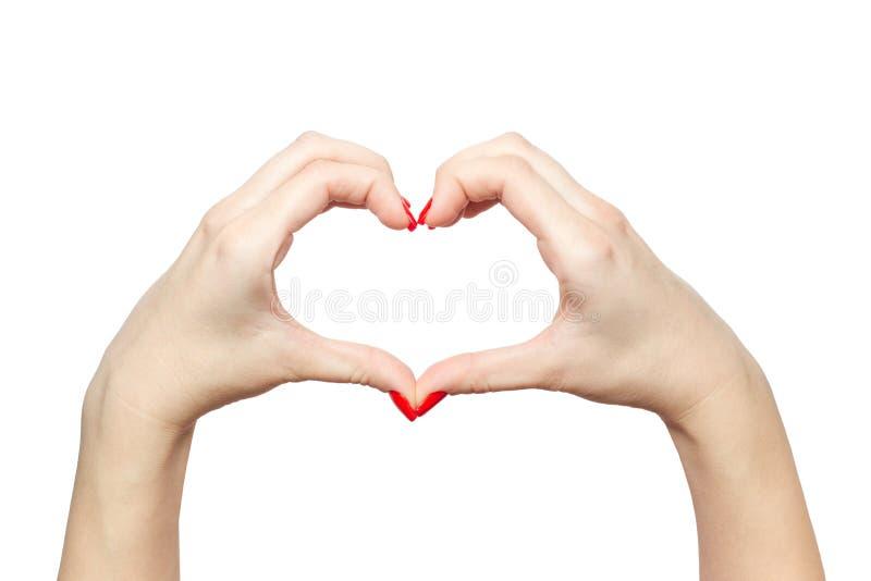 Frauenhände in Form von dem Herzen lokalisiert auf weißem Hintergrund stockfotos